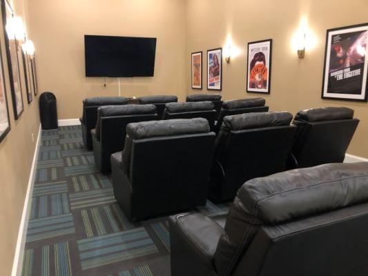 Theatre room with big screen TV & cinema-style seating