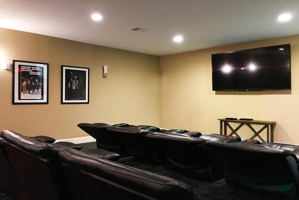 Theatre room w/big screen TV and cinema-style seating