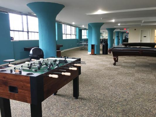 Community game room with billiards, shuffleboard, ping pong & foosball