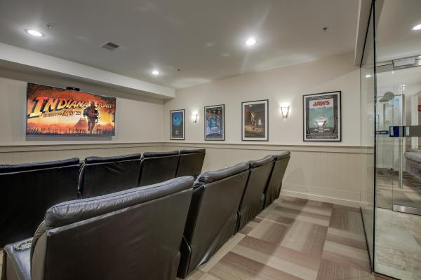 Community theatre room with big screen TV and cinema-style seating